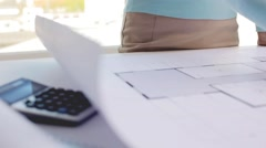 Woman with architectural blueprint and pencil Stock Footage