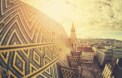 Retro stylized fisheye lens picture of Vienna at sunset. Stock Photos