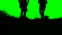 Silhouette of man and woman running  in Green screen background Stock Footage
