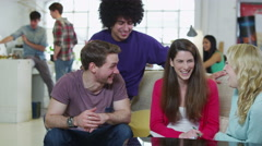Happy group of students studying together in their shared accommodation Stock Footage