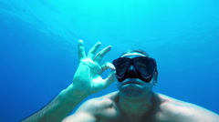 Free Diver Underwater Showing OK Sign in Slow motion. Stock Footage