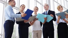 Business team with folders meeting at office 24 Stock Footage
