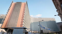 European Commission building exterior Berlaymont EU Union Brussels sunny wide Stock Footage