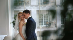 Wedding couple in love. Beautiful bride in white dress handsome groom embrace Stock Footage