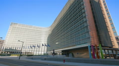 Berlaymont office building European Commission EU Union flags waving Brussels Stock Footage