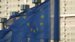 Close up EU flags waving wind Brussels European Union EU exterior sunny day Arkistovideo