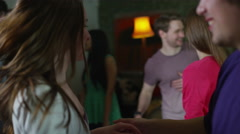 Carefree group of young friends, dancing and flirting together at a house party Stock Footage