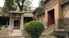Tourists visit territory of the historical Great Mosque in Xian, China. Stock Footage