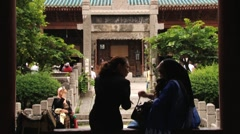 People visit territory of the historical Great Mosque in Xian, China. Stock Footage