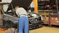 Engineer assemble car's engine on the conveyor Stock Footage