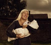 Portrait of a mother and child in medieval dress Stock Photos