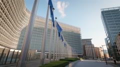 European Commission Union office flags wave Berlaymont building facade Brussels Stock Footage