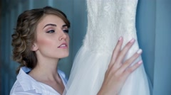 Bride is Watching a Wedding Dress Stock Footage