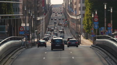Street traffic urban cityscape cars vehicles commute sunny day Brussels Stock Footage