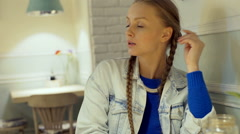 Irritated girl waiting for someone in the vintage cafe, steadycam shot Stock Footage