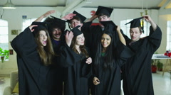 Portrait of college or university students on graduation day Arkistovideo