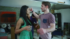 Happy and carefree group of young friends drinking and dancing at a house party Stock Footage