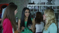 Happy and carefree group of young friends dancing and flirting at a house party Stock Footage