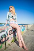 Young barefoot blond woman Stock Photos