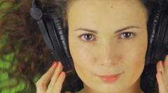 Thoughtful and attractive view of the girl in the headphones Stock Footage