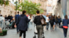 People walking on the street, not in focus Stock Footage