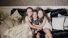 Three friends, little girls hugging Arkistovideo