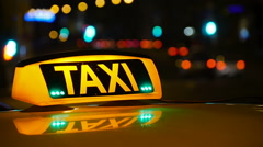Taxi driving with motion blur and city lights. Stock Footage