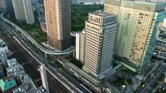 Tokyo - Aerial evening city view with trains and highway traffic. 4K resolution Stock Footage