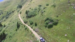Aerial View Of Jeep Driving Off road Through Rural Mountain Countryside Stock Footage