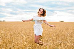 Beauty Girl Outdoors enjoying nature on the Field Stock Photos