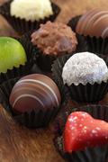 Assorted chocolates in wrappers Stock Photos