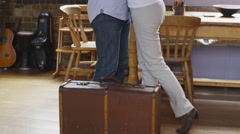 Attractive mature man with suitcase says goodbye Stock Footage