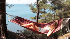 Young girl resting in a hammock Stock Footage