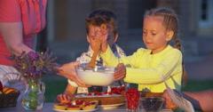 Grandma Teaching Kids to Cook Dessert Stock Footage