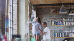 Happy couple in love working together to renovate their home Stock Footage