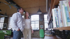 Modern couple in a large stylish loft style apartment Stock Footage