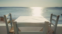4K table with sea view at Greek sunny island tavern Stock Footage