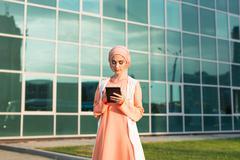 Modern Arabian woman with tablet computer Stock Photos