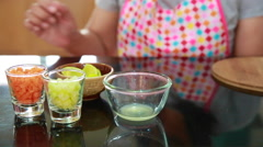 Asian cook squeeze lemon Stock Footage