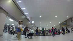 Passengers at Baggage Claim in Airport Waiting for Luggage. Timelapse. Stock Footage