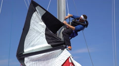 Sailboat Crew prepares the sails and rigging for racing Stock Footage