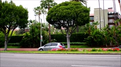 The Beverly Hill Hotel on Sunset Blvd.in Beverly Hills. and cars driving by Stock Footage