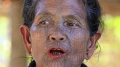 Portrait Chin woman with spider tattoo.  Tibeto Burman tribal people. Myanmar Stock Footage
