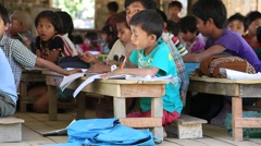 Burmese girls and boys in a local school during the lesson, Myanmar. Burma Stock Footage