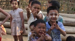 Poor children on the street in Myanmar . Poverty is a major issue in Burma Stock Footage