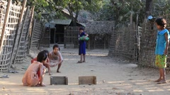 Poor children playing outdoor game on the street.  Burma, Myanmar Stock Footage