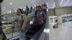Traveling People at Escalator at International Airport. Timelapse. Stock Footage