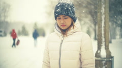 Young Asian Woman in winter park slowmotion Stock Footage