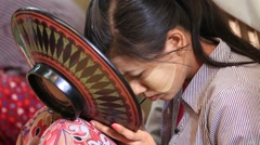 Woman working in a factory of lacquer souvenir. Myanmar, Burma Stock Footage