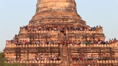 Tourists climbed to the pagoda, to take pictures of sunset over Bagan, Myanmar Stock Footage